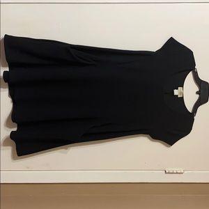 A plain below the knee black dress with pockets